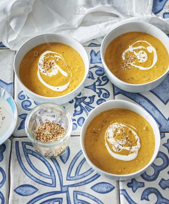 Carrot soup with yogurt and sesame seeds