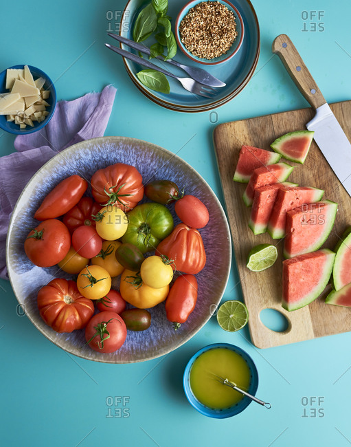 Preparing fruit and tomatoes for a salad