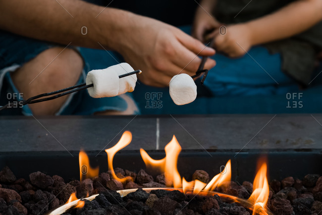 Marshmallows being roasted over a gas fire
