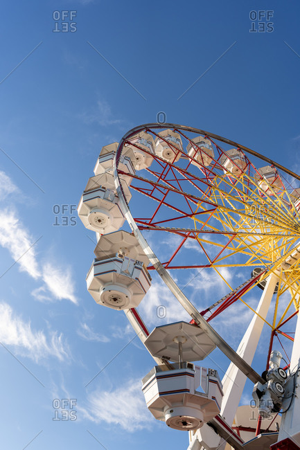 Low angle view of a colorful Ferris wheel at an amusement park