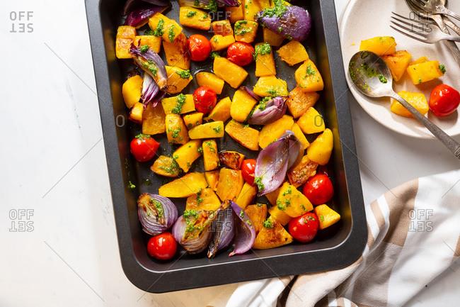 Baking sheet full of baked vegetables