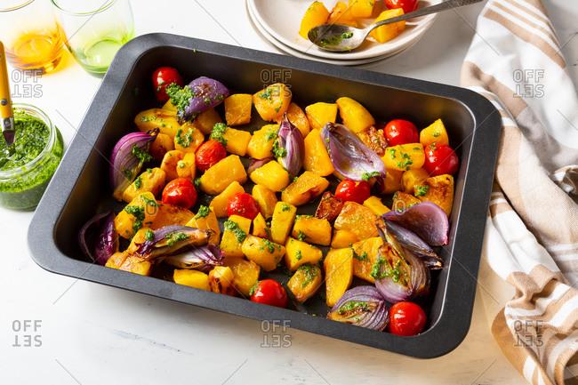 Baking sheet full of colorful baked vegetables