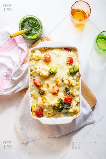 Pasta casserole with broccoli and tomato overhead view