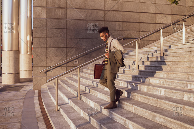 Businessman descending stairs of office building, Milano, Lombardia, Italy