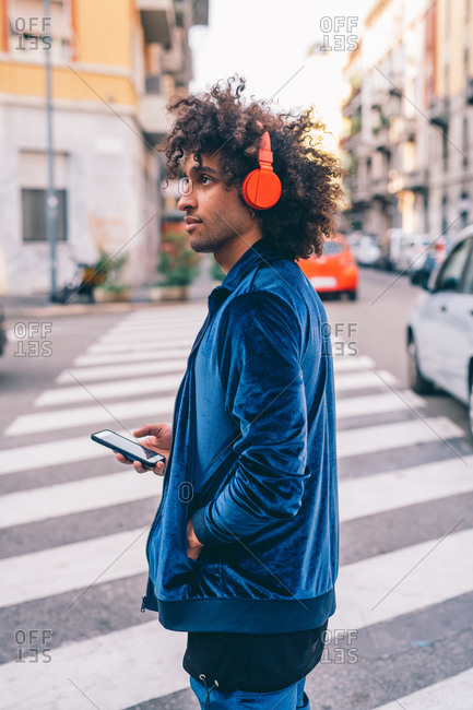 Young man exploring city, Milano, Lombardia, Italy