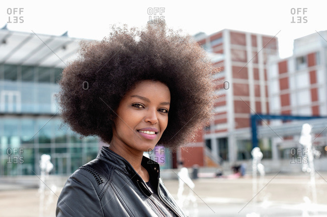 Young woman with afro hair on city concourse, portrait