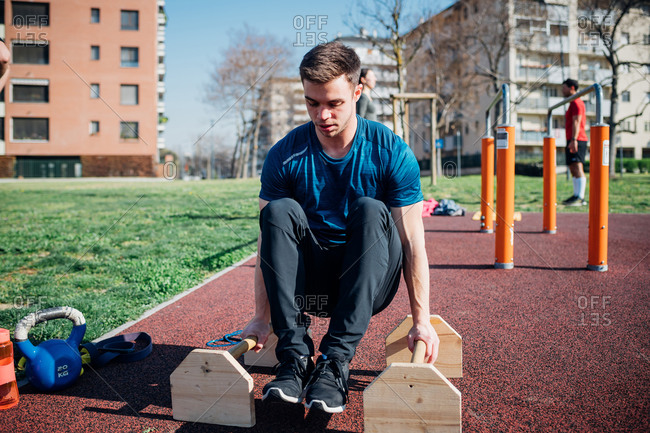 Calisthenics at outdoor gym, young man doing push ups