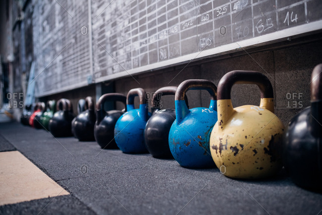 Scoreboards and kettlebells in gym