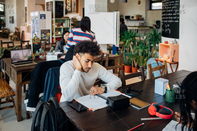 Young businessman remote working at cafe table
