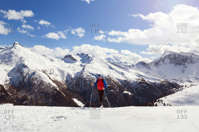 Mature male skier on snow covered mountain,  Styria, Tyrol, Austria