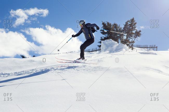 Mature man skiing down snow covered mountain,  Styria, Tyrol, Austria