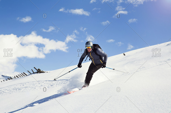 Mature man skiing down snow covered mountain,  Styria, Tyrol, Austria