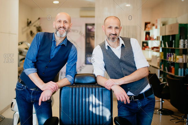 Happy business partners in barber shop