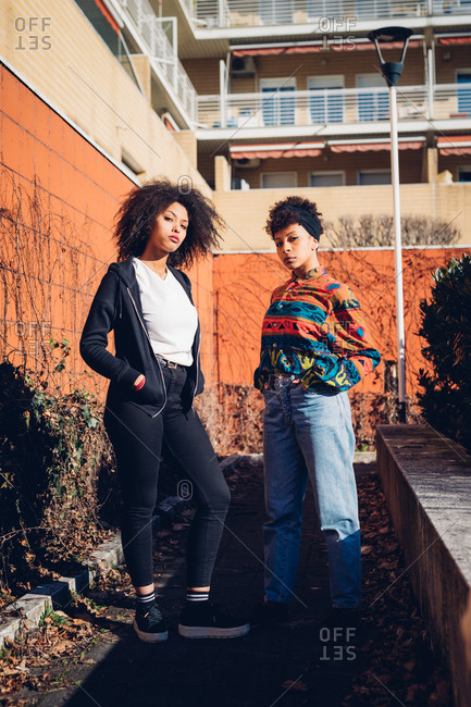 Two cool young female friends in urban garden, portrait