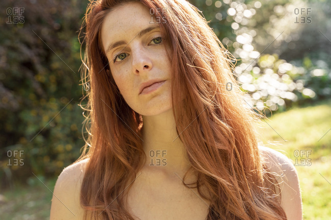 Portrait of a redheaded young woman outdoors