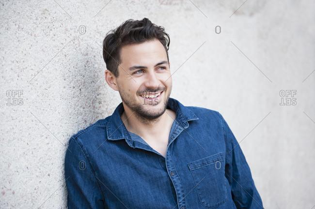 Smiling young man wearing denim shirt