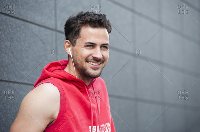Portrait of young jogger looking at camera