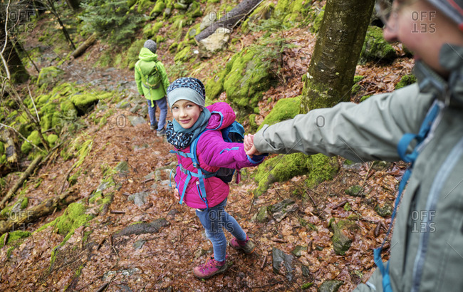 Girl leading mother along trail in Northern Black Forest during winter