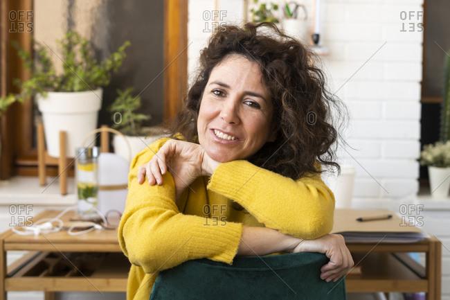 Portrait of brunette woman having a break in home office