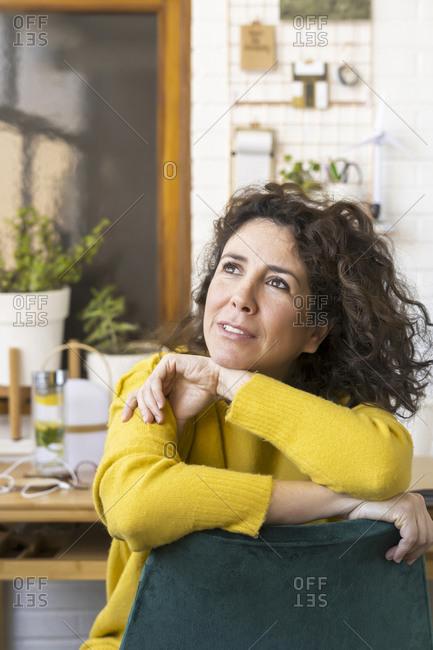 Brunette woman having a break in home office
