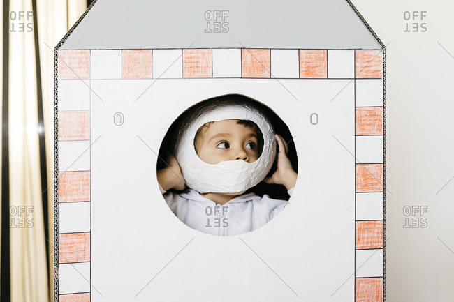 Girl playing astronaut in a rocket