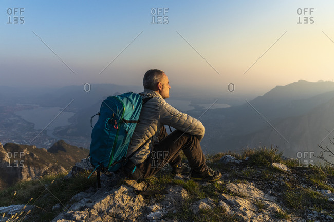 Hiker sitting on viewpoint- Orobie Alps- Lecco- Italy