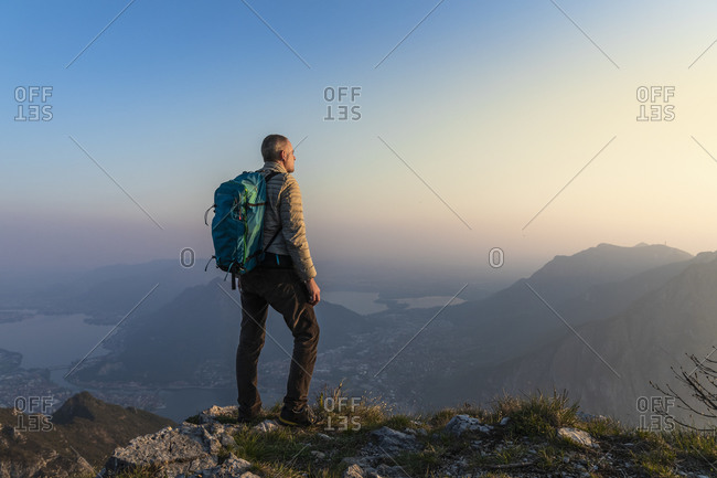 Rear view of hiker on mountaintop- Orobie Alps- Lecco- Italy