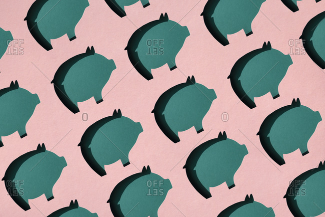 Pattern of rows of pig shaped paper cuts against pink background