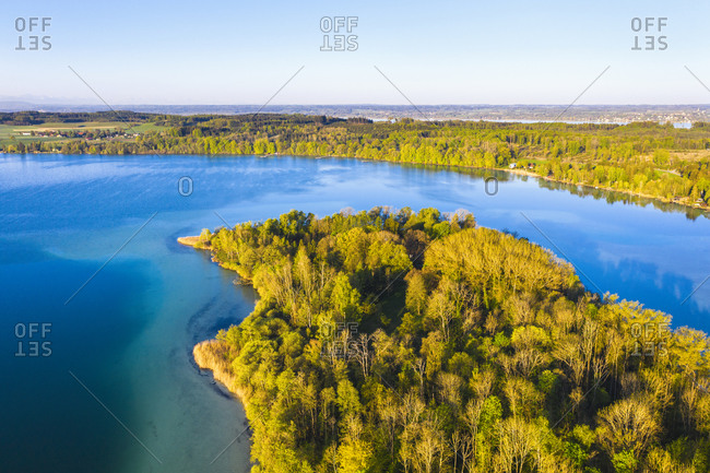 Germany- Bavaria- Inning am Ammersee- Drone view of clear sky over forested shore of Worth island