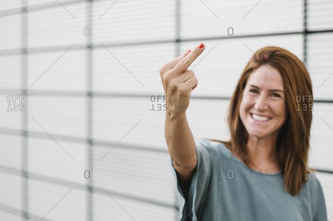 Female rebel giving the finger