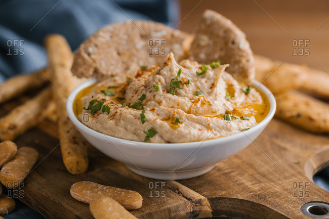Delicious homemade hummus with paprika, seeds and olive oil