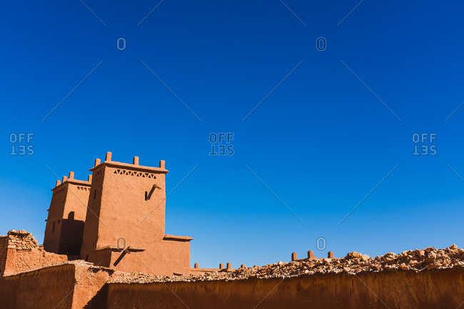 Magnificent scenery of facade of ancient clay buildings and walls in Ait Ben Haddou on sunny day
