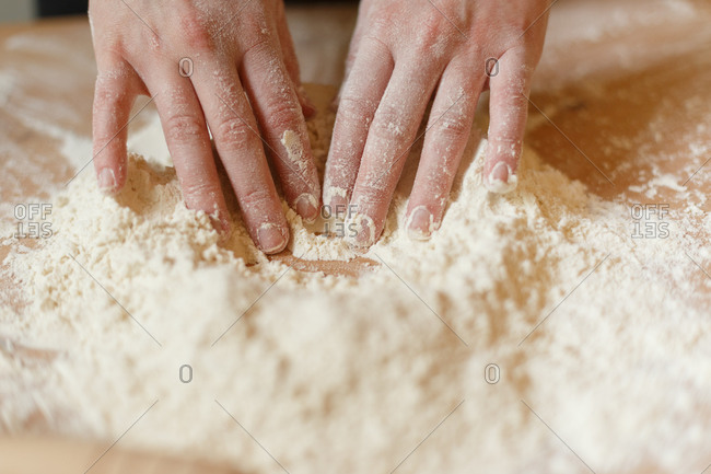 Closeup of some hands smeared with flour