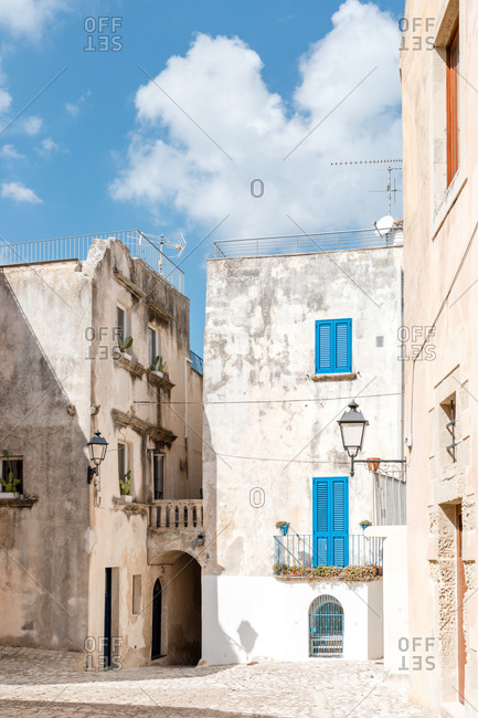 Buildings with blue shutters in the town of Otranto on the Salento peninsula, Puglia, southern Italy