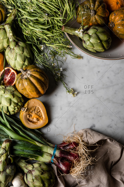 Abundance of fresh produce on marble counter