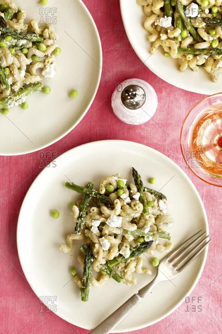 Roasted asparagus pea pasta with fresh pea pesto sauce served on plates