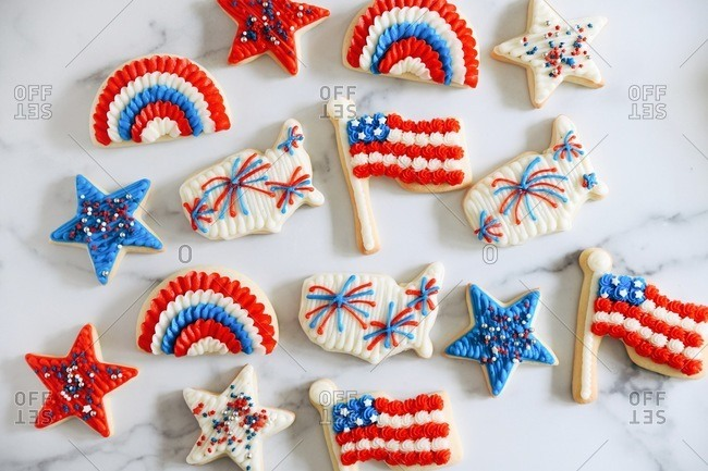 Patriotic holiday sugar cookies with red, white and blue frosting and sprinkles