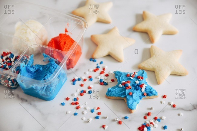 Star shaped sugar cookies with red, white and blue sprinkles and frosting from a day kit