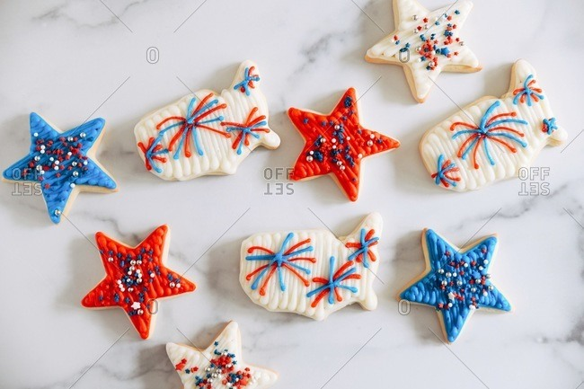 Sugar cookies with red, white and blue frosting and sprinkles in star and America shapes