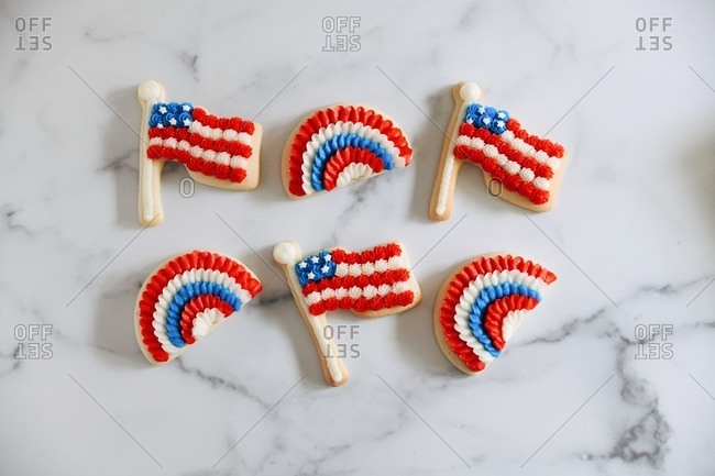 American flag and bunting sugar cookies on marble surface