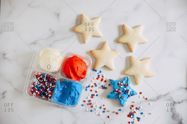 DIY star shaped sugar cookie kit with red, white and blue sprinkles and frosting
