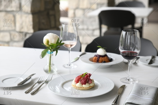 Gourmet desserts served in a restaurant with wine