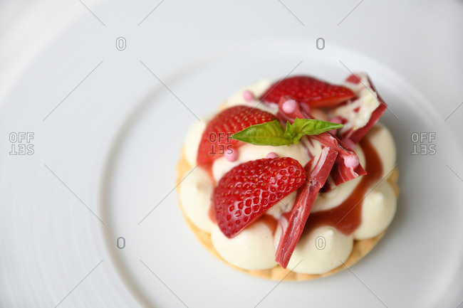 A gourmet strawberry pastry served in a restaurant