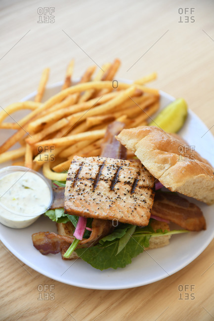 Grilled chicken and bacon sandwich served with French fries