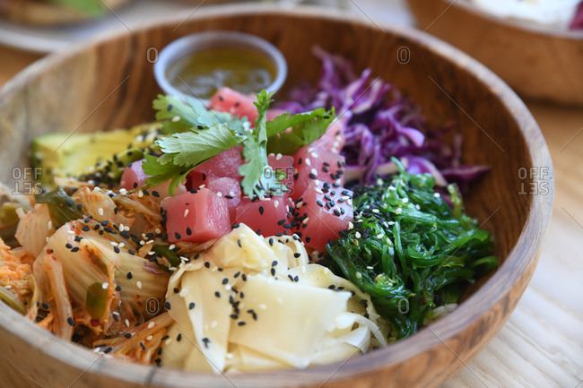 Close up of a tuna poke in a wooden bowl