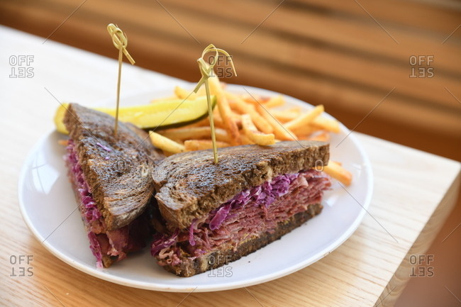 Roast beef and cabbage sandwich served with French fries