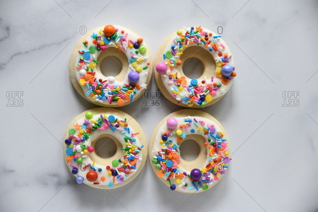 Donut shaped cookies topped with colorful sprinkles