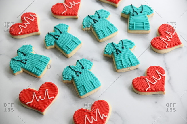 Sugar cookies in the shape of hearts and hospital scrubs