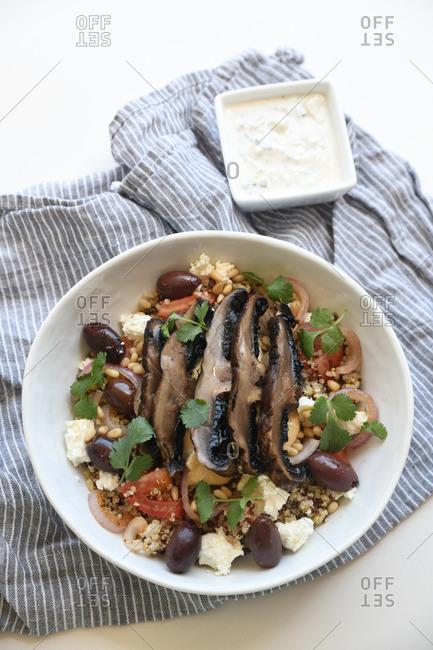 Gourmet dish with quinoa, olives and portobello mushrooms