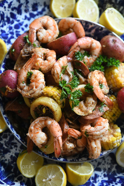 Close up of a shrimp boil with potatoes and corn